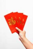 красный цвет удерживания руки габарита Китаев Стоковые Изображения