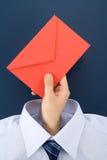 красный цвет удерживания руки габарита Стоковая Фотография