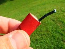 красный цвет фейерверка Стоковые Изображения