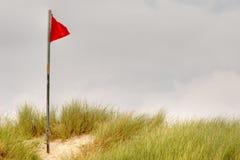 красный цвет флага пляжа Стоковое фото RF