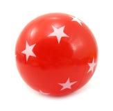Красный цвет шарика с белыми звездами Стоковое Фото