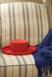 красный цвет шлема стула Стоковая Фотография