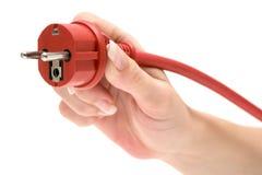 красный цвет штепсельной вилки удерживания Стоковые Фото