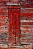 красный цвет двери старый Стоковая Фотография