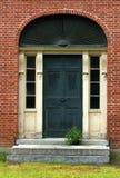красный цвет дома входа кирпича Стоковая Фотография