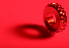 красный цвет 2 шестерен стоковое фото