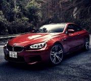КРАСНЫЙ ЦВЕТ BMW M4 стоковое изображение rf