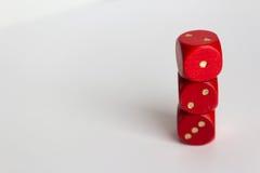 Красный цвет 3 dices на белой предпосылке - скопируйте космос Стоковые Изображения