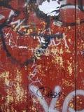 красный цвет grunge надписи на стенах предпосылки Стоковая Фотография