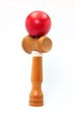 красный цвет kendama шарика Стоковые Изображения