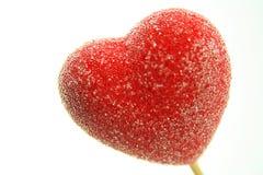 красный цвет lollipop сердца Стоковая Фотография