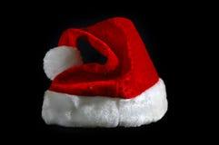 красный цвет santa шлема Стоковые Фото