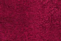 Красный цвет Terrycloth, предпосылка текстуры ткани крупного плана Высокое resoluti Стоковые Изображения