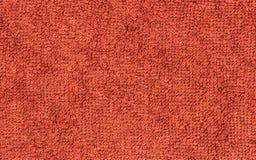 Красный цвет Terrycloth, предпосылка текстуры ткани крупного плана Стоковое Фото