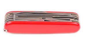 Красный швейцарский карманный нож армии на белой предпосылке Стоковые Фото