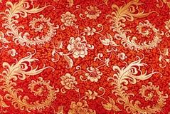 Красный шелк с флористической картиной Стоковое фото RF