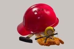 Красный шлем безопасности на белой предпосылке Трудная шляпа изолированная на whit Стоковое Изображение RF