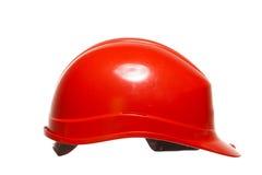 Красный шлем безопасности работника здания построителя изолированного на белизне Стоковая Фотография