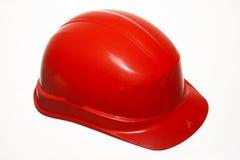 Красный шлем безопасности работника здания построителя изолированного на белизне Стоковые Фотографии RF