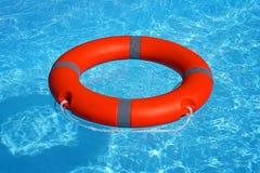 Красный lifebuoy поплавок кольца бассейна Стоковые Изображения