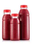 Красный smoothie ftruit в размере 3 бутылки Стоковые Фото