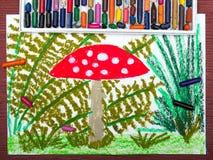 Красный toadstool в траве Стоковые Фото