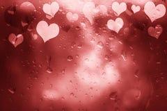 Красным абстрактным текстурированная стеклом предпосылка сердец Стоковые Изображения RF