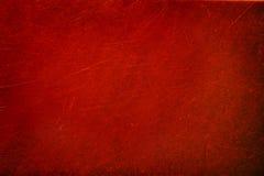 Красным предпосылка текстурированная grunge с царапинами Стоковая Фотография