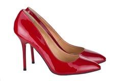 2 красных ботинка женщины изолированного на белизне Стоковые Фото