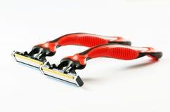 2 красных брея бритвы изображение наушников черноты близкое изолировало пусковую площадку микрофона мягко вверх по белизне Стоковые Изображения