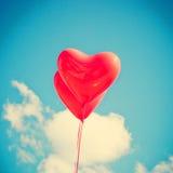 2 красных в форме Сердц воздушного шара Стоковая Фотография RF