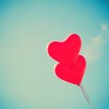 2 красных в форме Сердц воздушного шара Стоковая Фотография