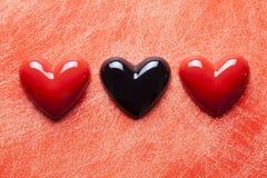 2 красных и одних черных сердца Стоковые Изображения
