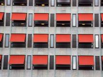 12 красных навесов на современном фасаде здания Стоковая Фотография RF