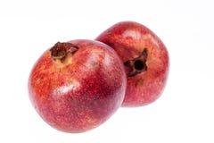 2 красных плодоовощ гранатового дерева изолированного на белой предпосылке Стоковые Изображения