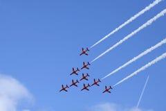 9 красных самолетов эффектного выступления Suisse Стоковые Фотографии RF