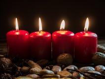 4 красных свечи рождества Стоковые Изображения