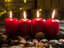4 красных свечи рождества Стоковые Изображения RF