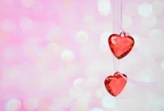 2 красных стеклянных сердца Стоковая Фотография