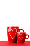 2 красных чашки чаю или кофе с сердцами Стоковая Фотография
