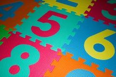 Красочная головоломка полового коврика номера пены Стоковые Фотографии RF