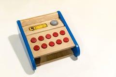 Красочная деревянная игрушка на белизне стоковое изображение rf