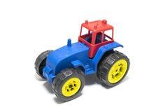 Красочная игрушка трактора изолированная на белой предпосылке Стоковые Фотографии RF