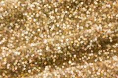Красочная искра и blowcolourful bokeh освещают в золотом цвете t Стоковое Изображение