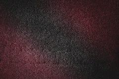 Красочная красная розовая абстрактная текстура с черной предпосылкой яркого блеска тона Стоковое Изображение