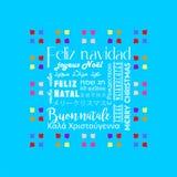 Красочная поздравительная открытка написанная в нескольких языков испанских, небесно-голубой цвет рождества Стоковые Фото
