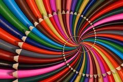 Красочная радуга точит фракталь картины предпосылки карандашей спиральную Переплетенная карандашами картина предпосылки Конспект  Стоковые Изображения RF