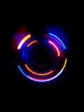 Красочная световая волна круга в темной предпосылке Стоковые Фото