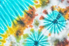 Красочной картина покрашенная связью на предпосылке хлопко-бумажной ткани Стоковое Изображение