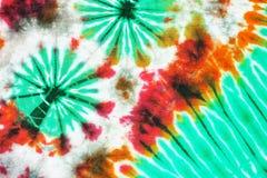 Красочной картина покрашенная связью на предпосылке хлопко-бумажной ткани Стоковые Изображения RF